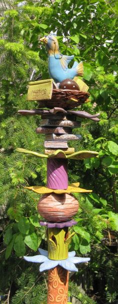 A bird-topped totem for the garden  / Primitiva Pottery / Maria root