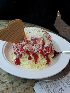By request, here's a spaghetti ice cream recipe:  1. Take vanilla ice cream or gelato and run it through a press to look like noodles. 2. Top it with strawberry sauce and grated white chocolate. Yum!   Spaghetti Eis - Ice Cream that looks like Spaghetti - created in Germany in the 60s and still loved today!