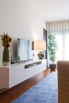Sala Comum_Zona de Estar, móvel TV: Salas de estar modernas por Traço Magenta - Design de Interiores