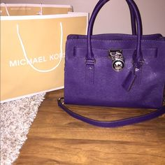 """JUST INMichael Kors Medium Hamilton NWTMK Medium Classic Hamilton Saffiano Leather in color """"Iris"""" which is a gorg deep purple colorMagnetic snap inside closure 1 inside zip pocket 4 inside open pockets and KEY FOB MK  LOGO LOCK&KEY Adjustable, detachable Leather shoulder strap with 20"""" drop Double Rolled leather handles with 5"""" drop 30"""" leather&chain shouder strap with 14.5"""" drop 12.5 L""""  X 9""""H X 5""""D Silver hardware NO TRADESAny questions pls feel free to ask(unfortunately I do not have the…"""