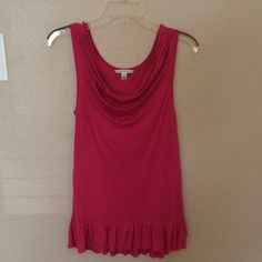 "Banana Republic Pink Long Ruffled Tank Pretty color, pleats and ruffles!  This tank is a little longer and hits on my hips (5'3"" tall). Perfect with leggings, jeans or shorts. Super cute!  Only worn twice. Drape front/cowl neck. Banana Republic Tops Blouses"