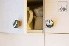 On this knobs are painted fragments of the pattern of the tiles