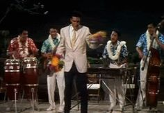 Click on GIF to make Elvis move! Elvis dances with others on stage