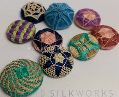 By Gina Barrett A few of my recent button trials - all are inspired by or based on historic examples. I tend to work most trials using a pearl cotton or spun silk, which means I don't feel guilty if it doesn't work and I need to cut a trial off of the button mould.