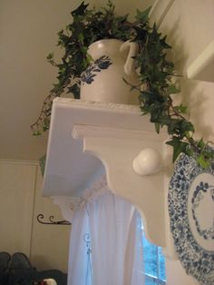 Side view of an over the window shelf with curtain rod