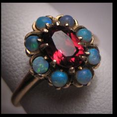 Opal and ruby. Vintage ring