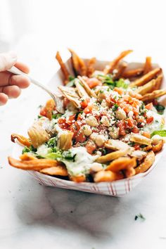 Loaded Mediterranean Street Cart Fries: sweet potato fries topped with fresh romaine, tzatziki, marinated tomatoes and chickpeas, feta cheese, and more. Meatless and mind-blowing, all in one. | pinchofyum.com
