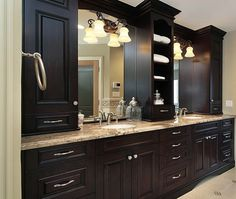 Find pre-fab cabinets and install on either side of bathroom mirror for storage.
