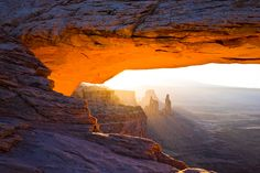Canyonlands National Park, UT    Burning Mesa Arch at sunrise with the sun rays beaming through the valley.