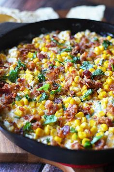 Cheesy Bacon Jalapeno Corn Dip. The sprinkle of basil seems weird but it's so amazing. This is a new football sunday must-have. Game day appetizer at its finest! | hostthetoast.com