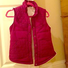 Roxy Pink Ruffle Snap Vest Roxy Pink Ruffle Snap down vest with ruffles and hearts; She'll - 100% Polyester; inside warm, Soft and fuzzy cream colored; very girly; lightly worn Roxy Jackets & Coats