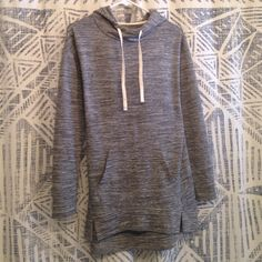 Long Hooded Grey Sweatshirt Extra long hooded grey sweatshirt with front kangaroo pouch. Wear it with leggings or skinny jeans - it's soft and comfortable! Slightly longer in back than at front. Only worn once. Mossimo Supply Co. Tops Sweatshirts & Hoodies