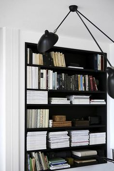 All of us have stacks upon stacks of magazines. I love the way this bookcase was styled with them.