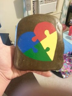 Autism awareness puzzle piece heart painted rock i made made for my best friend