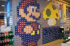 Mario and mushroom, made from soda cans.
