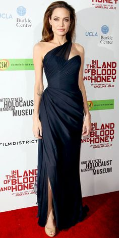 Angelina Jolie  WHAT SHE WORE  Jolie premiered In the Land of Blood and Honey in an asymmetrical Romona Keveza gown and nude Jimmy Choo peep-toes
