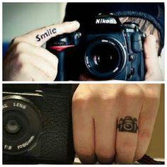 Nikon Camera And Tiny Camera Tattoo On Finger