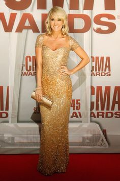 CMA Awards co-host Carrie Underwood shines on the red carpet in Nashville on Nov. 9, 2011.