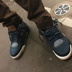 8aa39f3bebca44 Travis Scott flexes an all new Levi s x Air Jordan 4. Would you cop