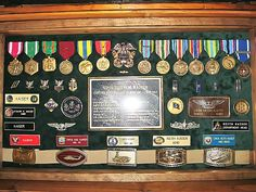 Another nice shadow box idea. Antique Trunk Used as Navy Retirement Shadow Box and Storage Chest