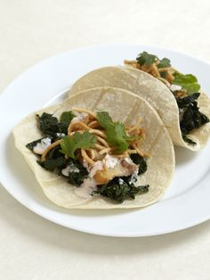 The flavors of Southeast Asia meet Mexico in these black kale pork tacos.