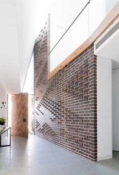 "Protruding bricks create an eye-catching pattern on this feature wall. [PGH Bricks](http://www.pghbricks.com.au/?utm_campaign=supplier/|target=""_blank"") in Mowbray Blue. Photo: Peter Bennetts"