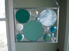 Ocean Waves Stained Glass Circle Panel. $24.99, via Etsy. again good colours and interesting shapes