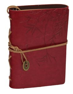 Beautiful embossed Bamboo Design Genuine leather journal, antique-style coin ornament and interior metal binder with unlined blank paper. Features pages made entirely from recycled fabric and biomass,