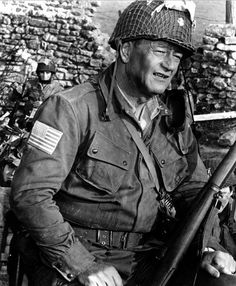 """John Wayne in """"The Longest Day"""" the right wing loves him & calls him a """"hero"""", but he never served one day in the US Military, & only played the parts of heroes in his movies, which he got paid millions for acting in. John Wayne, Old Movies, Great Movies, Classic Hollywood, Old Hollywood, Le Jour Le Plus Long, Chat Web, Film Mythique, Omaha Beach"""