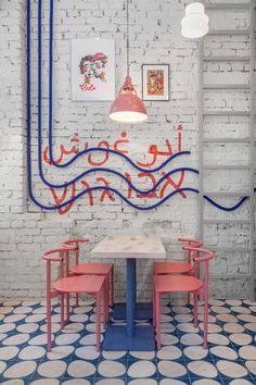 A Colorful Street Food Restaurant Concept in Moscow STUDIO SHOO designed the interior of Abu Ghosh, a street food restaurant in Moscow with a playful palette of blue, pink, and yellow accents.
