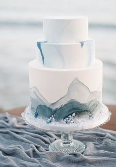dusty blue and grey wedding cake inspired by the ocean itself