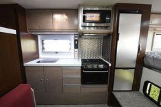 Cirrus 920 Truck Camper Review Kitchen, https://www.truckcampermagazine.com/camper-reviews/2018-cirrus-920-review/