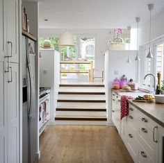 Love the countertops and the fact that the kitchen is on a lower level than the dining area