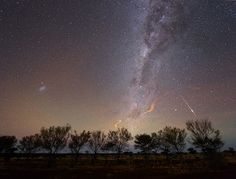 A meteor flashes, while the remnants of two others still glow in the Australian night sky. Photo by Colin Legg.