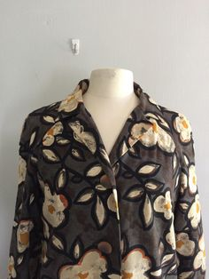 A personal favorite from my Etsy shop https://www.etsy.com/listing/245043484/vinatge-1960s-floral-coat-floral-rain