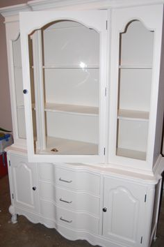 Refinished china cabinet-I have this same one. Maybe black and use silver hardware? Then pain the table black and recover the chairs. A completely fresh new look. Hmmm...