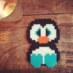 Penguin hama beads by dijana_tev, this would be good to get the shapes or could you ice in this pattern? Melty Bead Patterns, Pearler Bead Patterns, Perler Patterns, Beading Patterns, Perler Beads, Fuse Beads, Hama Beads Design, Pixel Pattern, Iron Beads