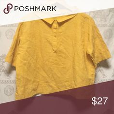 Exaggerated collar top Mustard color exaggerated collar halfway buttons down has a baggy crop top feel. Looks great with hi Rise jeans Tops