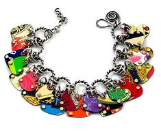 """""""Charmed Hearts Convertible Bracelet & Necklace""""  Metal Bracelet or Necklace    Created by Beth Taylor  The artist's signature piece, this is two pieces of jewelry in one! Easily converts from bracelet to necklace with included extender chain. Charms are made from recycled tin cans."""