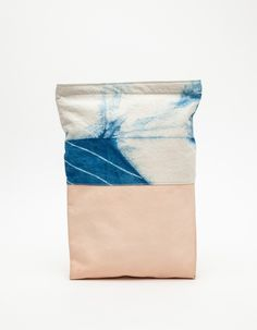 Shibori dyed cotton canvas foldover clutch from Job & Boss with leather detailing, hand-dipped in indigo and featuring cotton lining and top zip closure.  100% Cotton 12oz Canvas Duck, 100% Leather  Handmade in USA