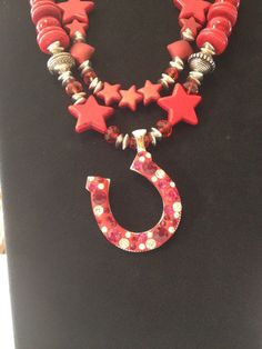 Cowgirl Bling / Red Turquoise / Bling Horseshoe Pendant. $48.00, via Etsy.