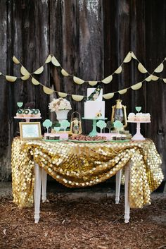 I like the idea of one flashy table! guest book table or dessert table....  gold - garland + table dressing / pink desserts
