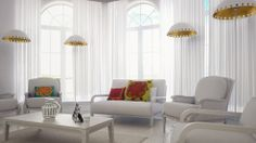 Quito White Floor lamp with shiny gold color inside.  A Greek Roman style modern cottage with white sofas  and couches. Multiple seating areas. The curtains are full length and are of a transparent white color. The arch wood large windows add a Victorian touch to this wonderful American Italian interior design. The Quito Floor lamp is a wonderful atmosphere lamp but it also provides great lighting and a golden lighting effect.