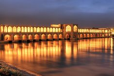 The Khaju Bridge or Pol-e-Khajoo in Isfahan, Iran, was built in the 17th century by Shah Abbas II in the great Islam era destiny. Besides having beautiful golden look during the night, the bridge also serves as a dam, with sluice gates under the archways. At the center of the bridge, there are two large pavilions, called the Prince Parlors, that were originally reserved for the Shah.