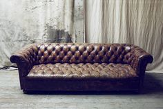 Blood & Champagne.  LOVE this style of couch!  Though it would totally NOT be comfortable in which to watch tv.