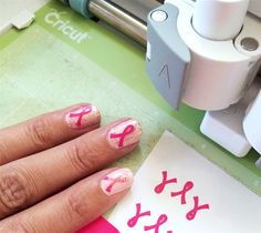 Show off your support for your favorite cause with this quick and easy Nail Art Craft. Make your own mini ribbon nail decals in whatever color you'd like! Whether it's pink ribbons or rainbow ribbons, you can create the look that fits your passion.- Support Ribbon Nail Art - JGoode Designs - DIY Awareness ribbon - Made with Cricut Explore - Nail Art