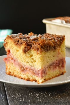 Classic Strawberry Rhubarb Coffeecake made extraordinary with a layer of strawberry rhubarb filling and a brown sugar cinnamon crumb topping. Perfect for brunch or dessert.