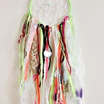 Handmade dream catcher  Bright green hoop with white, teal, black, beige,  mint, pink, glitter and gold accents/beading/jewels/ ribbon/fabric/feathers/etc.  Hoop and webbing measure aprox. 5 inches across and measures aprox. 19 inches in length