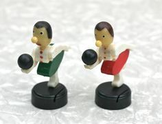 Strike!    Two little ladies ready to bowl....one in green and one in red skirt. These are hard to find novelty place card holders with the slits in their bases. Hand painted plastic and stamped on the bottom Made In Hong Kong by Mafco. Good vintage condition. Great to hold business cards!    Each lady stands about 3 1/2 high.    PLEASE NOTE~Last photo shows a box which is NOT included in this listing. It is just to show what the original manufacturers box looked like.