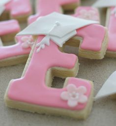 """Pre-school graduation cookie for Miss Emma -- the cap is made using a diamond cutter, the """"hat"""" part is a square cutter cut on a diagonail --"""